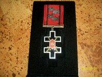 Apdovanojimus, ženklus ir monetas į kolekciją